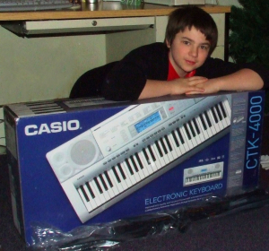 Young Tony posing with a CASIO CTK-4000